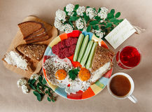 Delicious Tasty Breakfast from Eggs,Bread with Butter,Sausage on the Colorful Plate.Coffee,Red Juice  with White Flowers.Wish Card Stock Photos