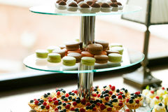 Delicious and tasty dessert table at wedding reception macaroons Stock Photos