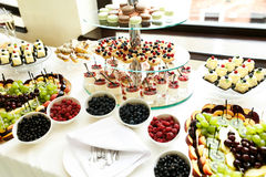 Delicious and tasty dessert table at wedding reception macaroons Royalty Free Stock Photo