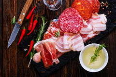 Delicious and tasty meat dishes. On the board Royalty Free Stock Image