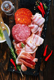 Delicious and tasty meat dishes. On the board Royalty Free Stock Photography