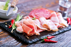 Delicious and tasty meat dishes. On the board Stock Image