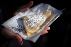 Delicious Tasty streetfood crepes. Close up of a crepe holded by woman hands Royalty Free Stock Photography