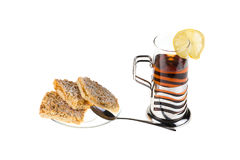 Delicious tea with lemon and biscuits Royalty Free Stock Photo