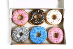 Delicious and tempting box full of donuts with different flavours and toppings sugar addiction concept. Delicious and tempting box full of donuts with different Royalty Free Stock Photo