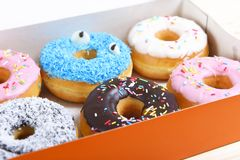 Delicious and tempting box full of donuts with different flavours and toppings sugar addiction concept Royalty Free Stock Photo