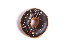 Delicious tempting chocolate donut with toppings unhealthy nutrition sugar sweet addiction concept Royalty Free Stock Photos