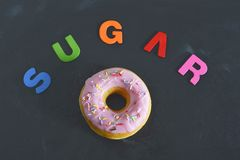 Delicious tempting donut with toppings unhealthy nutrition sugar addiction concept Stock Photos