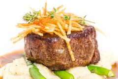 Delicious tenderloin steak with asparagus. Royalty Free Stock Photography