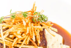 Delicious tenderloin steak with french fries. Stock Photo