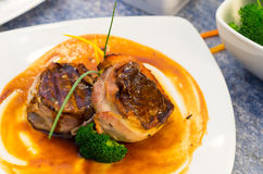 Delicious tenderloin steak wrapped in bacon and Stock Photography