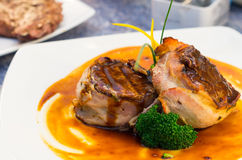 Delicious tenderloin steak wrapped in bacon and Royalty Free Stock Photography