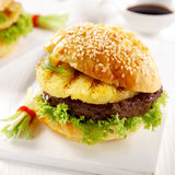 Delicious teriyaki pineapple burger. With a grilled pineapple ring on a beef patty and crispy lettuce served on a freshly baked sesame bun for summer lunch Royalty Free Stock Photos