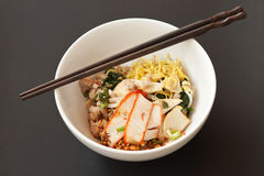 Delicious Thai dry noodle with chopstick Stock Photo