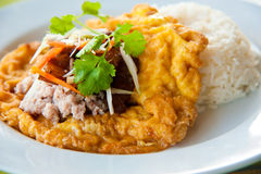 Delicious Thai food : Hot rice with omelet Royalty Free Stock Images