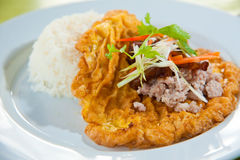 Delicious Thai food : Hot rice with omelet Royalty Free Stock Photo