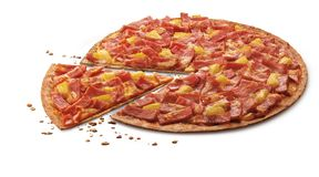 Delicious thin flame grilled ham and pineapple pizza with mozzarella. Cheese and crack isolated on white stock photo