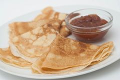 Delicious Thin Pancakes with Apple Jam on White Plate. Breakfast Isolated. royalty free stock images