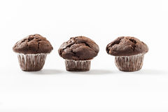 Delicious three chocolate muffins Stock Image