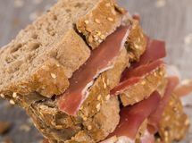 Tiered sandwich made with with rye bread and ham. Delicious tiered sandwich made with with rye bread and ham Royalty Free Stock Photos
