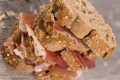 Tiered sandwich made with with rye bread and ham Stock Photos