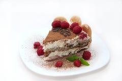 Delicious tiramisu. Delicious Italian dessert tiramisu decorated with raspberries Royalty Free Stock Photography