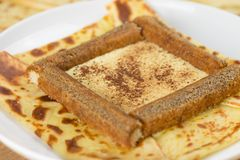 Detail of Delicious tiramisu crepes filled with mascarpone, coffee and chocolate powder. French crepe with italian tiramisu. Delicious tiramisu crepe filled with stock images