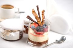 Delicious tiramisu dessert in a glass, restaurant serve. Cream bakery plate pastry food white chocolate closeup tasty slice sweet cake cafe cheesecake portion royalty free stock photography