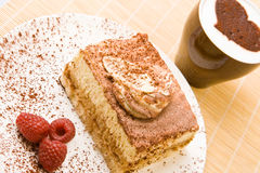 Delicious tiramisu with raspberries and cappuccino. Fresh tiramisu with raspberries and cappuccino Royalty Free Stock Photography