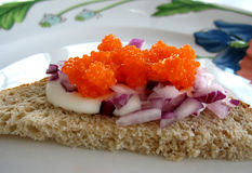 Delicious Toast. Sour cream on toast with red onion and roe Stock Photography