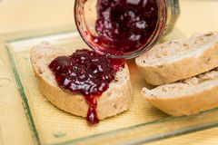 Delicious toast with jam on table close-up. Delicious toast with jam on table close-up stock image