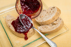 Delicious toast with jam on table close-up. Delicious toast with jam on table close-up stock images