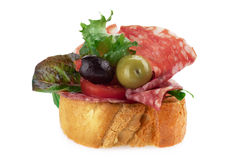 Delicious toasted crostini topped with Salami Stock Images