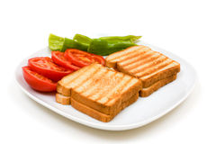 Delicious toasts with tomatoes and peppers. Delicious toasts with sliced tomatoes and green peppers. Isolated on white background Royalty Free Stock Photo