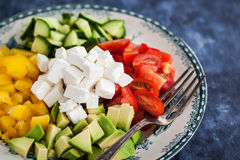 Delicious tomato, bell pepper, cucumber, avocado, onion and feta Stock Images