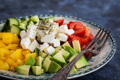 Delicious tomato, bell pepper, cucumber, avocado, onion and feta Royalty Free Stock Images