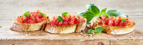 Delicious tomato bruschetta slices on a board Royalty Free Stock Photography