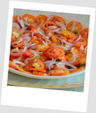 Delicious tomato salad. To inspire all the inner chefs inside you.cooking is an art royalty free stock image