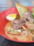 Delicious tomyam pork born with egg Stock Photography