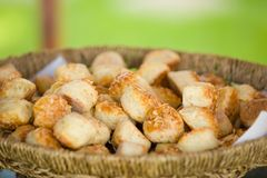 Delicious traditional hungarian baked snack with cheese in basket, outdoor royalty free stock photography