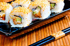 Delicious traditional Japanese rolls close-up Stock Photos