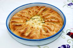 Delicious traditional pie with spinach and cheese stock images