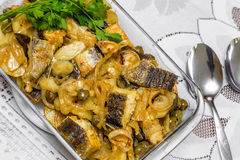 Delicious and traditional portuguese codfish with potatoes Stock Image