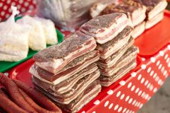 Delicious traditional russian and ukranian meat food smoked sausage and lard on the city market table, colorful and tasty. stock photography