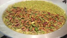 Delicious traditional Turkish kunefe with pistachio on it. stock footage