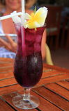 Delicious tropical drink on wood table Royalty Free Stock Images