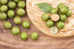 Fresh ripe peeled quenepa fruit - Melicoccus bijugatus. Delicious Tropical Fruit Mamoncillo - Melicoccus bijugatus Royalty Free Stock Photo