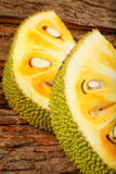 Delicious tropical  jack fruit slices. On a wooden background Stock Photos