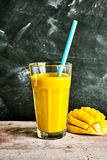Delicious tropical mango smoothie Stock Images