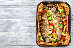 Delicious trout fish grilled with potatoes, broccoli, lemon Royalty Free Stock Photo